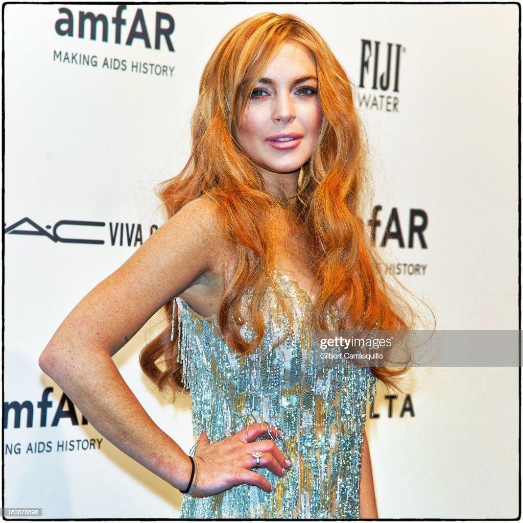 Lindsay Lohan attends amfAR New York Gala To Kick Off Fall 2013 Fashion Week at Cipriani, Wall Street on February 6, 2013 in New York City.