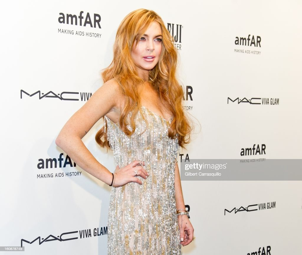 Lindsay Lohan attends amfAR New York Gala To Kick Off Fall 2013 Fashion Week at Cipriani, Wall Street on February 6, 2013 in New York City.