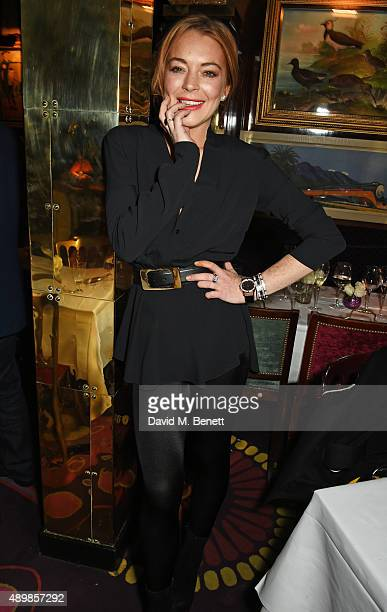 Lindsay Lohan attends Annabel's for an intimate dinner and exclusive performance with Selena Gomez at Annabel's on September 24 2015 in London England