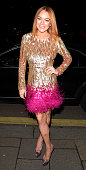 Lindsay Lohan attends Chopard Christmas Party at Annabel's member's club in Mayfair on December 2 2014 in London England