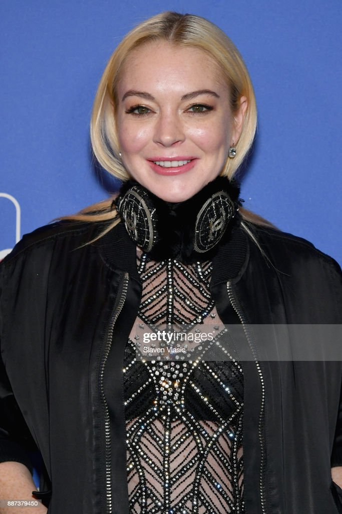 Lindsay Lohan attends DailyMail.com & DailyMailTV Holiday Party with Flo Rida on December 6, 2017 at The Magic Hour in New York City.