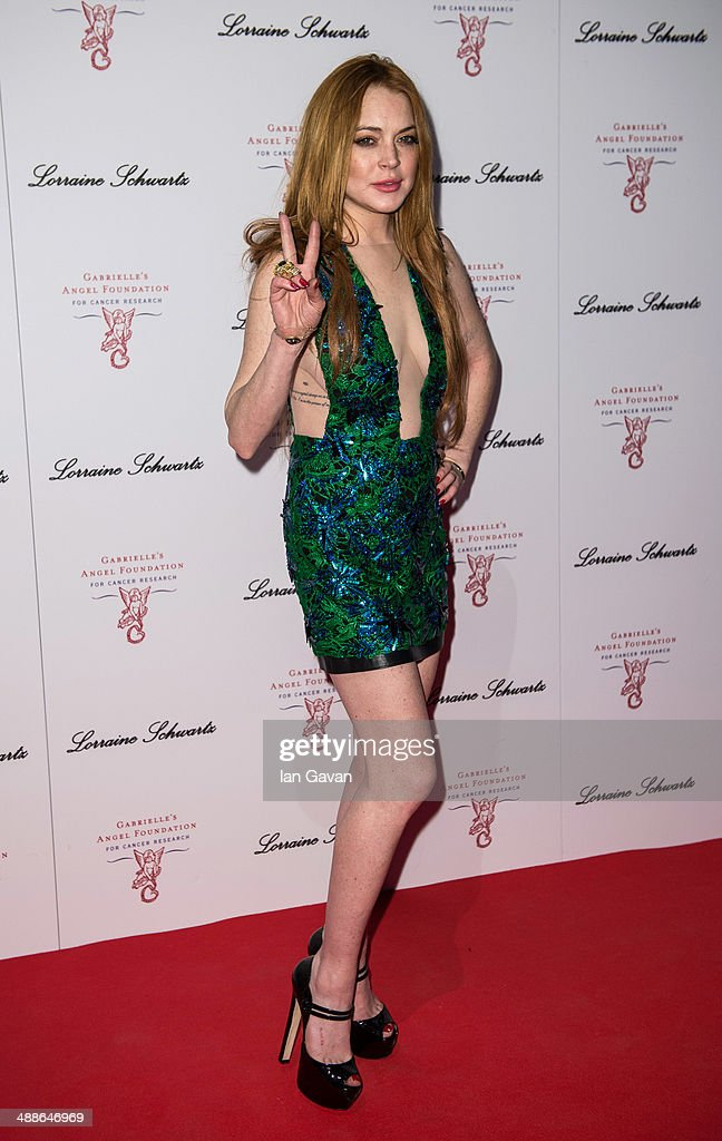 <a gi-track='captionPersonalityLinkClicked' href=/galleries/search?phrase=Lindsay+Lohan&family=editorial&specificpeople=171623 ng-click='$event.stopPropagation()'>Lindsay Lohan</a> attends Gabrielle's Gala at Old Billingsgate Market on May 7, 2014 in London, England. Gabrielle's Gala is an annual fundraiser in aid of Gabrielle's Angel Foundation for Cancer.