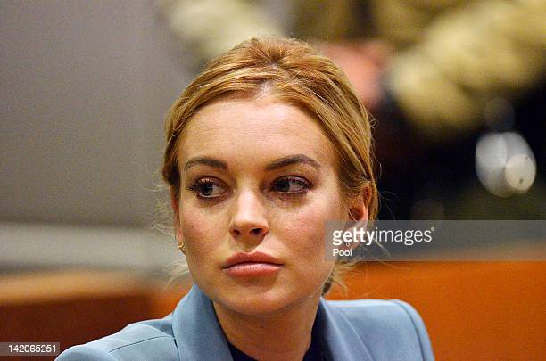 Lindsay Lohan attends her probation hearing with attorney Shawn Chapman Holley at the Airport Courthouse on March 29 2012 in Los Angeles California...
