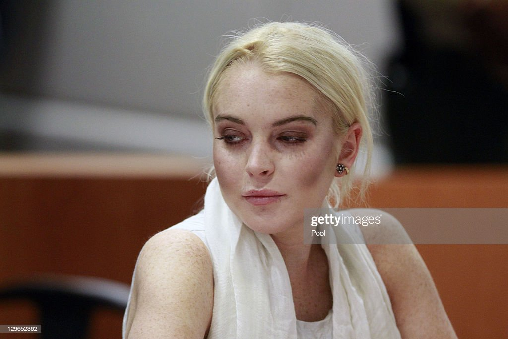 Lindsay Lohan attends her probation progress report hearing the Airport Courthouse on October 19, 2011 in Los Angeles, California. Judge Stephanie Sautner suspended Lohan's probation and bail has been set at USD 100,000 after Lohan was terminated by the Downtown Women's Center for repeatedly failing to appear for community service. If Lohan posts bail she has been ordered to community service for 16 hours per week at the L.A. County coroner's office until her next court date on November 2. Lohan has been sentenced to a total of 480 hours of community service stemming from a 2007 drunk-driving conviction and a jewelry theft conviction earlier this year.