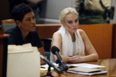 Lindsay Lohan attends her probation progress report hearing with her lawyer Shawn Chapman Holley at the Airport Courthouse on October 19 2011 in Los...