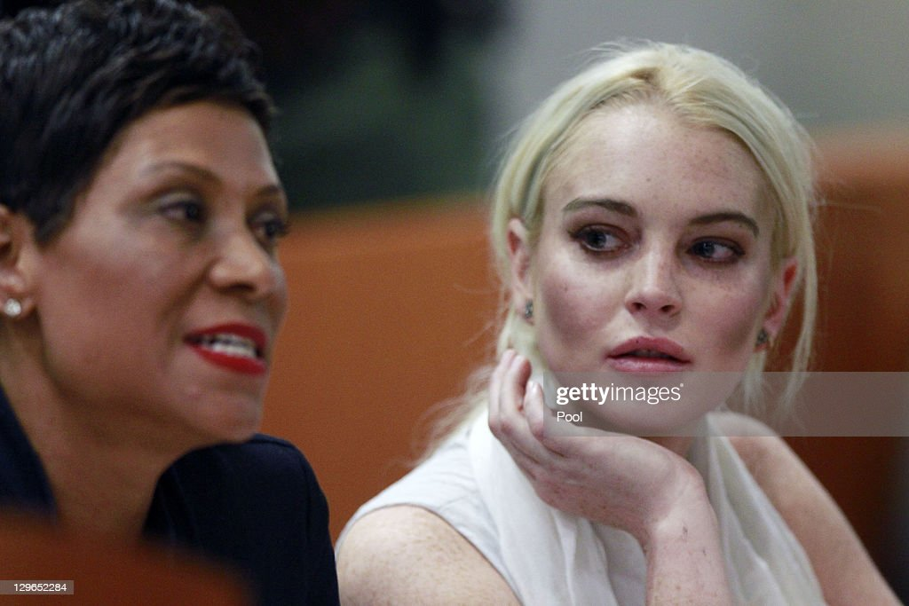 <a gi-track='captionPersonalityLinkClicked' href=/galleries/search?phrase=Lindsay+Lohan&family=editorial&specificpeople=171623 ng-click='$event.stopPropagation()'>Lindsay Lohan</a> attends her probation progress report hearing with her lawyer <a gi-track='captionPersonalityLinkClicked' href=/galleries/search?phrase=Shawn+Chapman+Holley&family=editorial&specificpeople=5763122 ng-click='$event.stopPropagation()'>Shawn Chapman Holley</a> at (L) the Airport Courthouse on October 19, 2011 in Los Angeles, California. Judge Stephanie Sautner suspended Lohan's probation and bail has been set at USD 100,000 after Lohan was terminated by the Downtown Women's Center for repeatedly failing to appear for community service. If Lohan posts bail she has been ordered to community service for 16 hours per week at the L.A. County coroner's office until her next court date on November 2. Lohan has been sentenced to a total of 480 hours of community service stemming from a 2007 drunk-driving conviction and a jewelry theft conviction earlier this year.