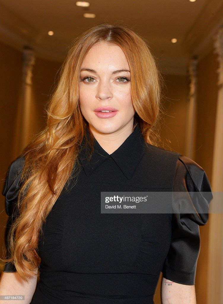 <a gi-track='captionPersonalityLinkClicked' href=/galleries/search?phrase=Lindsay+Lohan&family=editorial&specificpeople=171623 ng-click='$event.stopPropagation()'>Lindsay Lohan</a> attends The 59th Women of the Year Lunch at the InterContinental Park Lane Hotel on October 13, 2014 in London, England.
