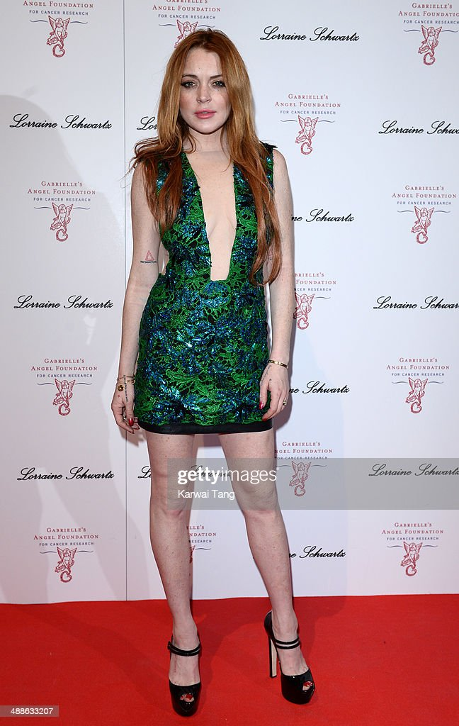 <a gi-track='captionPersonalityLinkClicked' href=/galleries/search?phrase=Lindsay+Lohan&family=editorial&specificpeople=171623 ng-click='$event.stopPropagation()'>Lindsay Lohan</a> attends the Gabrielle's Gala at Old Billingsgate Market on May 7, 2014 in London, England. Gabrielle's Gala is an annual fundraiser in aid of Gabrielle's Angel Foundation for Cancer research
