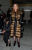 Lindsay Lohan attends the Gareth Pugh show during London Fashion Week Fall/Winter 2015/16 at Victoria Albert Museum on February 21 2015 in London...