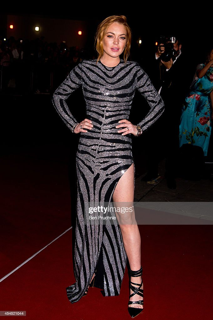 <a gi-track='captionPersonalityLinkClicked' href=/galleries/search?phrase=Lindsay+Lohan&family=editorial&specificpeople=171623 ng-click='$event.stopPropagation()'>Lindsay Lohan</a> attends the GQ men of the year awards at The Royal Opera House on September 2, 2014 in London, England.