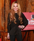 Lindsay Lohan attends the 'Just Sing It' app launch event at Pravda on December 16 2013 in New York City