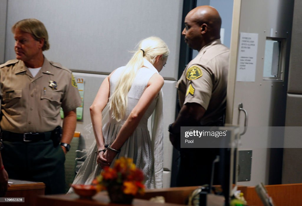 <a gi-track='captionPersonalityLinkClicked' href=/galleries/search?phrase=Lindsay+Lohan&family=editorial&specificpeople=171623 ng-click='$event.stopPropagation()'>Lindsay Lohan</a> is led away in handcuffs at her probation progress report hearing at the Airport Courthouse on October 19, 2011 in Los Angeles, California. Judge Stephanie Sautner suspended Lohan's probation and bail has been set at USD 100,000 after Lohan was terminated by the Downtown Women's Center for repeatedly failing to appear for community service. If Lohan posts bail she has been ordered to community service for 16 hours per week at the L.A. County coroner's office until her next court date on November 2. Lohan has been sentenced to a total of 480 hours of community service stemming from a 2007 drunk-driving conviction and a jewelry theft conviction earlier this year.