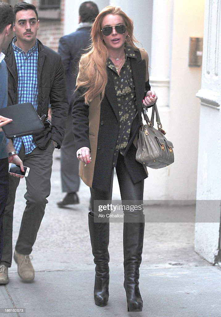<a gi-track='captionPersonalityLinkClicked' href=/galleries/search?phrase=Lindsay+Lohan&family=editorial&specificpeople=171623 ng-click='$event.stopPropagation()'>Lindsay Lohan</a> is seen in Soho on October 28, 2013 in New York City.