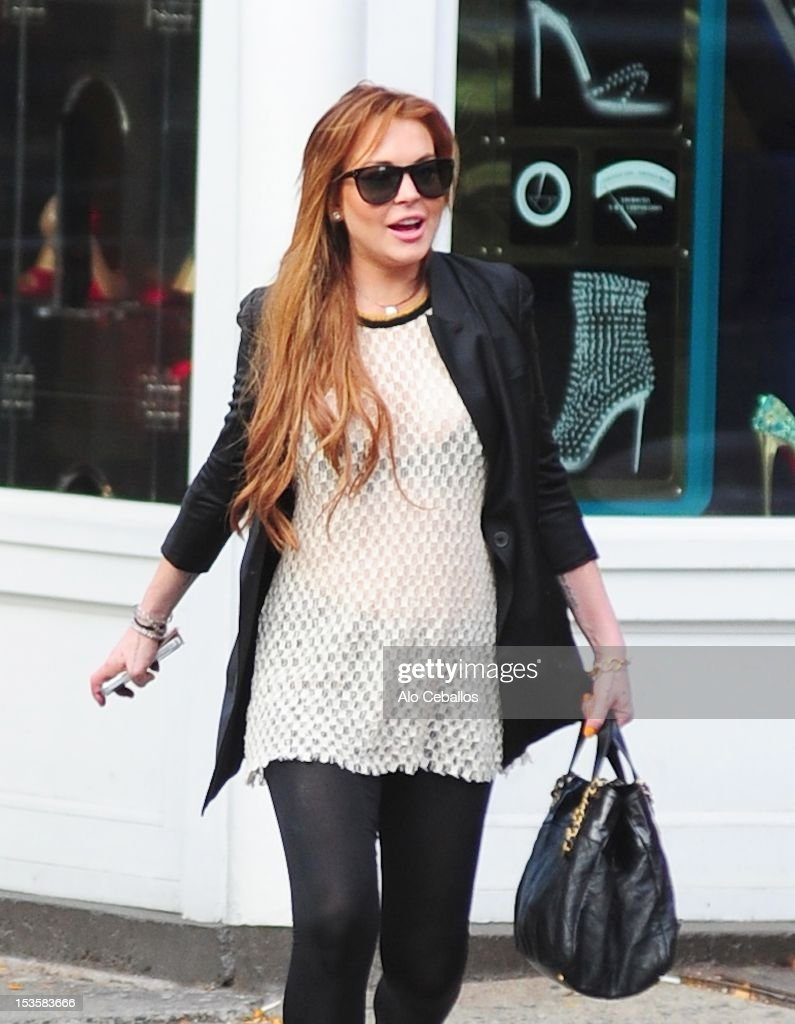 <a gi-track='captionPersonalityLinkClicked' href=/galleries/search?phrase=Lindsay+Lohan&family=editorial&specificpeople=171623 ng-click='$event.stopPropagation()'>Lindsay Lohan</a> is seen in the Meat Packing District at Streets of Manhattan on October 6, 2012 in New York City.