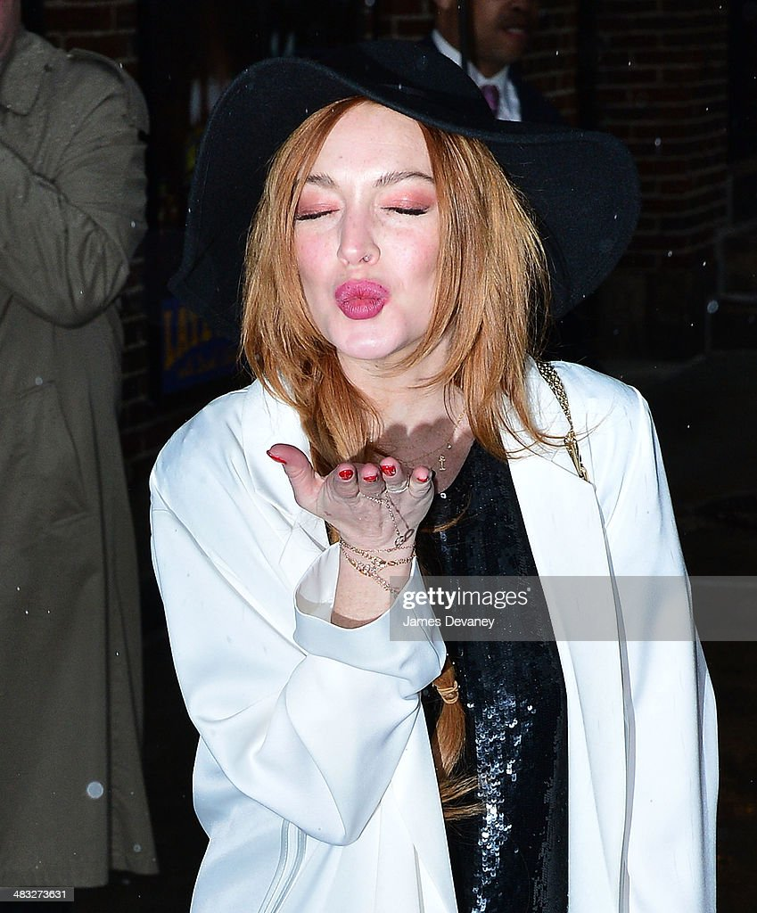 Lindsay Lohan leaves the 'Late Show With David Letterman' at Ed Sullivan Theater on April 7, 2014 in New York City.