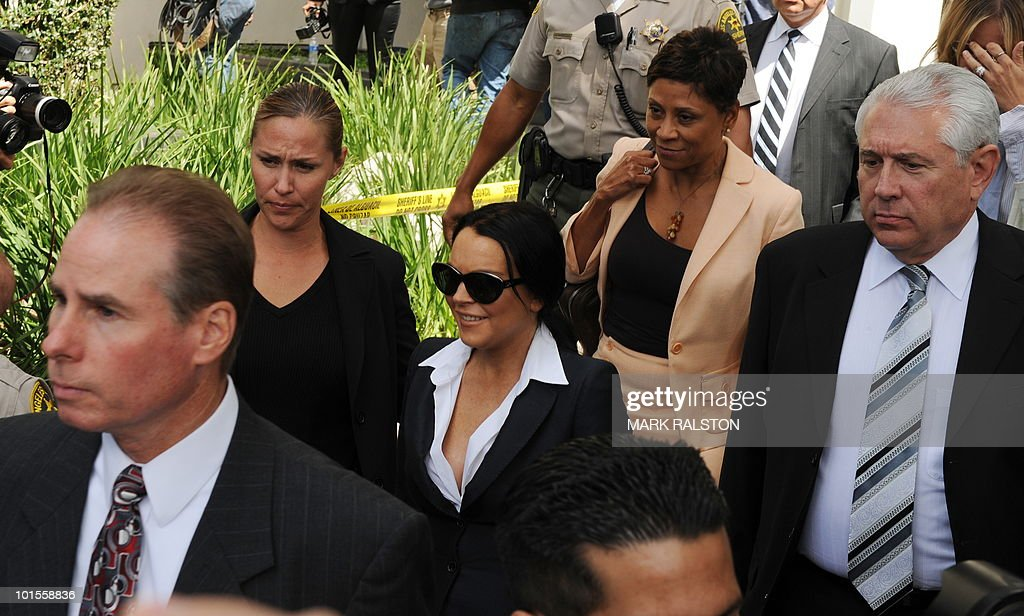Lindsay Lohan (C) leaves with her lawyer Shawn Chapman Holley (2nd R) after a hearing to respond to allegations she has not completed a set number of alcohol education classes, at the Beverly Hills Courthouse on May 24, 2010. Lindsay Lohan who failed to appear for a court hearing in Los Angeles last week, prompted a judge to issue an arrest warrant that was later withdrawn when lawyers for the troubled actress posted bail. Lohan, 23, had been ordered to appear before Judge Marsha Revel to respond to allegations she has not completed a set number of alcohol education classes required under the terms of her probation. AFP PHOTO/Mark RALSTON