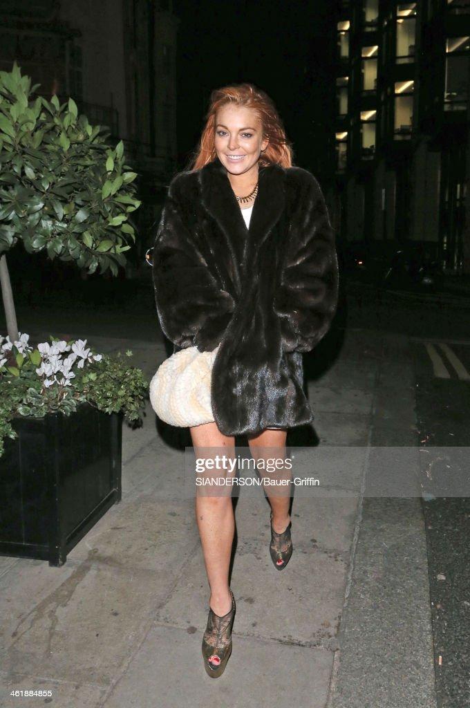 Lindsay Lohan leaving Boujis nightclub in London on December 31, 2012 in London, United Kingdom.