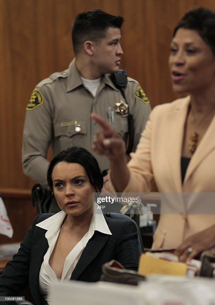 Lindsay Lohan listens as her lawyer Shawn Chapman Holley (R) speaks during a hearing to respond to allegations she has not completed a set number of alcohol education classes, at the Beverly Hills Courthouse on May 24, 2010. Lindsay Lohan who failed to appear for a court hearing in Los Angeles last week, prompted a judge to issue an arrest warrant that was later withdrawn when lawyers for the troubled actress posted bail. Lohan, 23, had been ordered to appear before Judge Marsha Revel to respond to allegations she has not completed a set number of alcohol education classes required under the terms of her probation. AFP PHOTO/POOL/Jae C. HONG