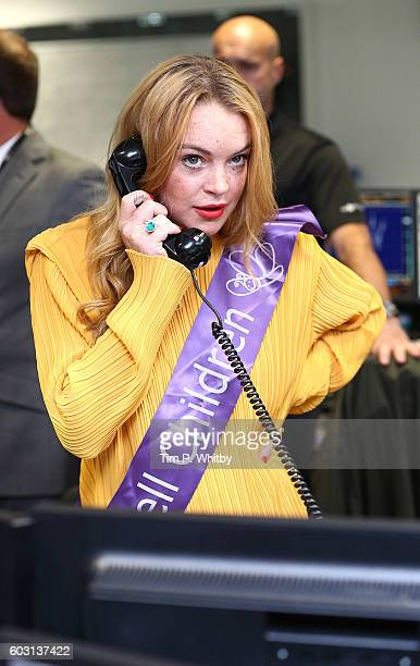 Lindsay Lohan making a trade at BGC Annual Global Charity Day at Canary Wharf on September 12 2016 in London England