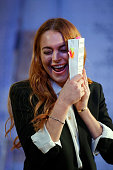 Lindsay Lohan performs during a photocall for 'Speed The Plow' at Playhouse Theatre on September 30 2014 in London England