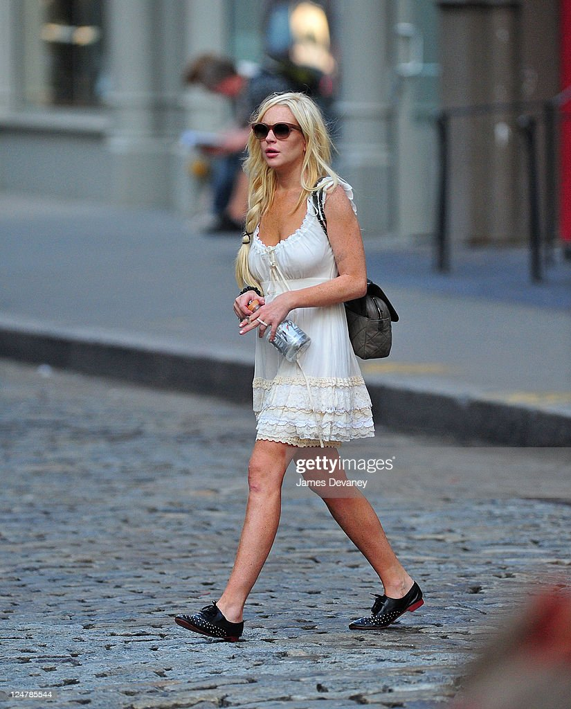 <a gi-track='captionPersonalityLinkClicked' href=/galleries/search?phrase=Lindsay+Lohan&family=editorial&specificpeople=171623 ng-click='$event.stopPropagation()'>Lindsay Lohan</a> seen on the streets of SoHo on September 12, 2011 in New York City.