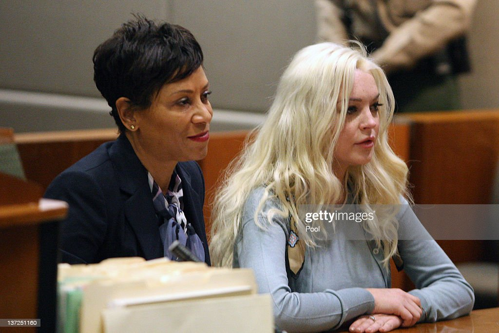 Lindsay Lohan sits in court for her probation update hearing with her attorney Shawn Chapman Holley at the Airport Courthouse on January 17 2012 in...