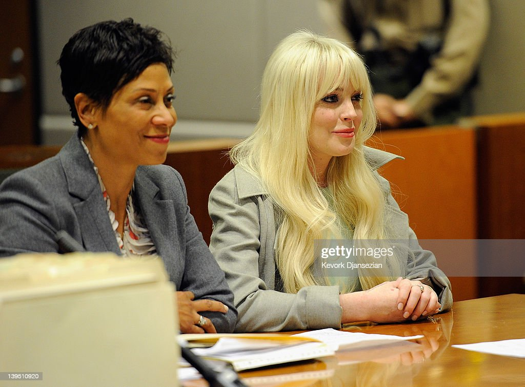 Lindsay Lohan sits in court for her probation update hearing with attorney Shawn Chapman Holley at the Airport Courthouse on February 22 2012 in Los...