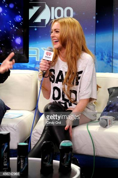 Lindsay Lohan speaks backstage at Z100's Jingle Ball 2013 presented by Aeropostale at Madison Square Garden on December 13 2013 in New York City