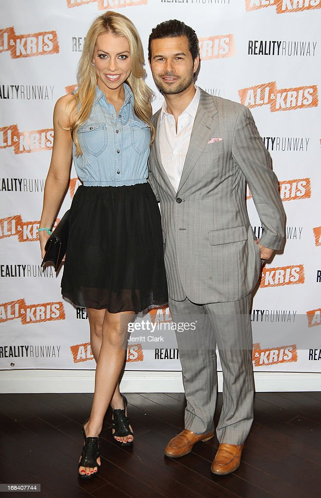 Lindsay McCormick poses with Jason Hoffman of Ali and Kris at the Reality Runway By Ali And Kris at the Ali and Kris Showroom on May 8, 2013 in New York City.