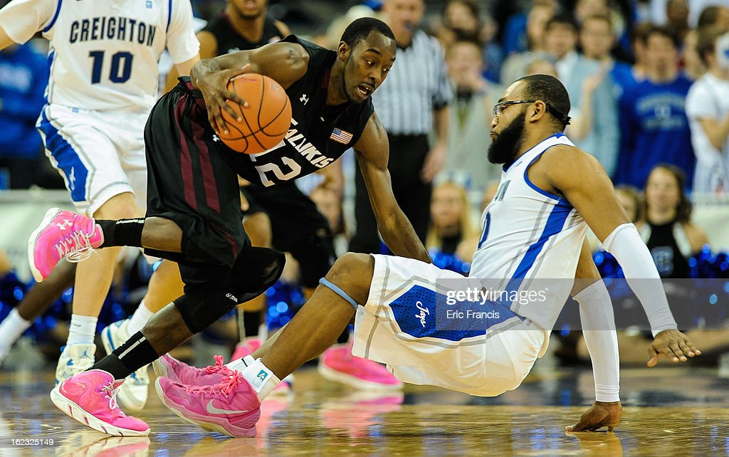 T.J. Lindsay #12 of the Southern Illinois Salukis charges into <a gi-track='captionPersonalityLinkClicked' href=/galleries/search?phrase=Gregory+Echenique&family=editorial&specificpeople=5648736 ng-click='$event.stopPropagation()'>Gregory Echenique</a> #00 of the Creighton Bluejays at the CenturyLink Center on February 19, 2013 in Omaha, Nebraska.