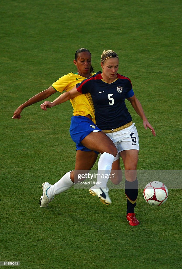 Lindsay Tarpley of the United States and Rosana of Brazil fight for control of the ball against the USA during the International Friendly Match...