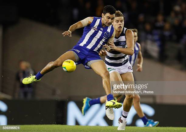 Lindsay Thomas of the Kangaroos and Jake Kolodjashnij of the Cats compete for the ball during the 2016 AFL Round 12 match between the Geelong Cats...