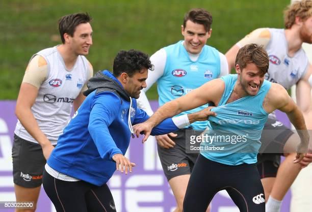 Lindsay Thomas of the Kangaroos and Luke McDonald of the Kangaroos wrestle during a North Melbourne Kangaroos AFL training session at Arden Street...