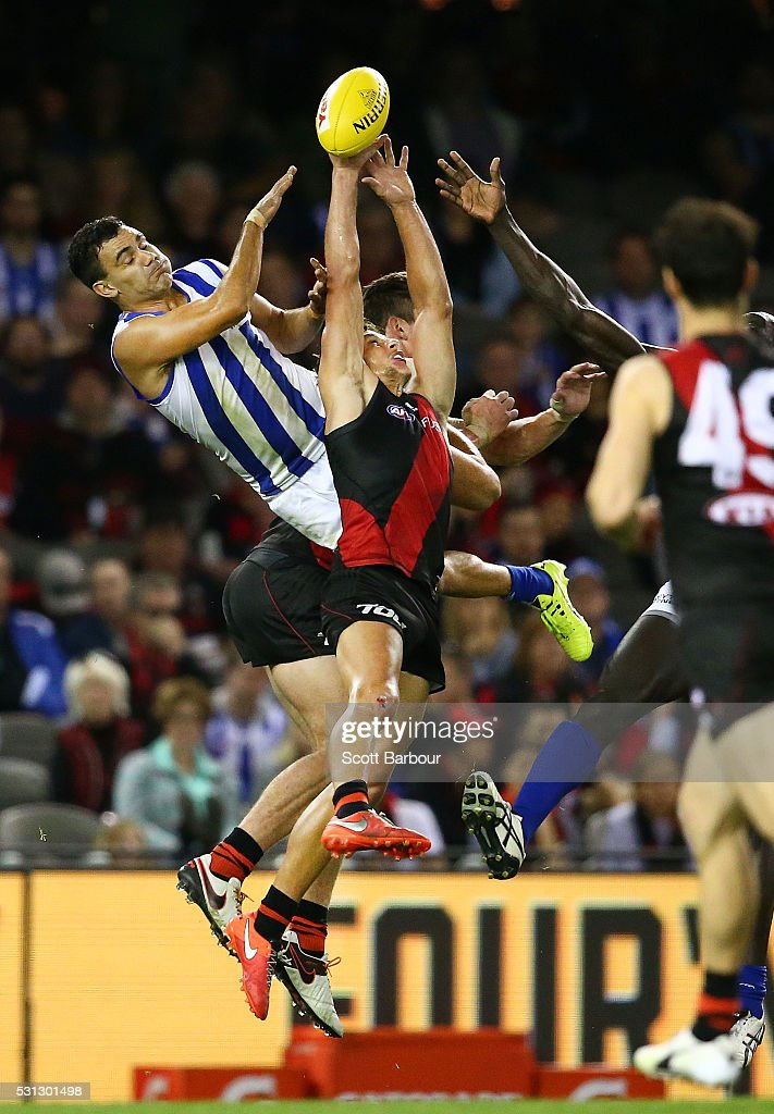 Lindsay Thomas of the Kangaroos attempts to take a spectacular mark during the round eight AFL match between the Essendon Bombers and the North Melbourne Kangaroos at Etihad Stadium on May 14, 2016 in Melbourne, Australia.