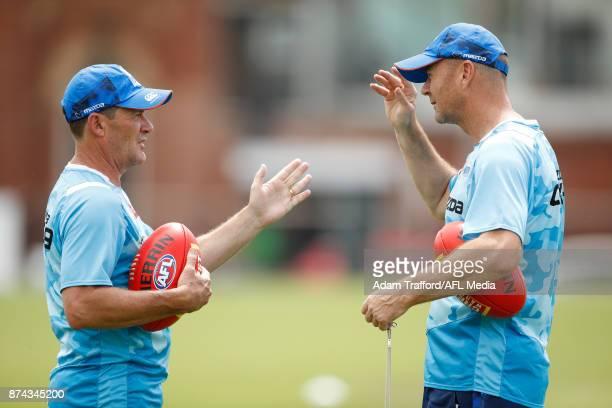 Lindsay Thomas of the Kangaroos chats to Darren Crocker Director of Coaching of the Kangaroos during the North Melbourne Kangaroos training session...