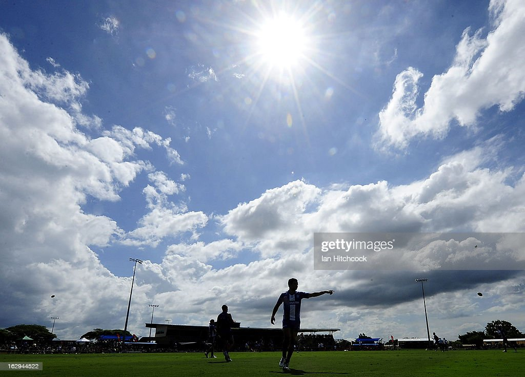 Lindsay Thomas of the Kangaroos gestures at the warm up before the start of play during the round two AFL NAB Cup match between the Gold Coast Suns and the North Melbourne Kangaroos at Tony Ireland Stadium on March 2, 2013 in Townsville, Australia.