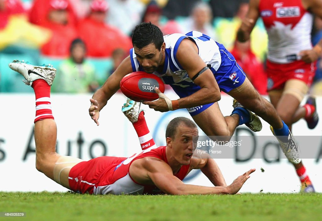 Lindsay Thomas of the Kangaroos is tackled by Ted Richards of the Swans during the round four AFL match between the Sydney Swans and the North Melbourne Kangaroos at Sydney Cricket Ground on April 13, 2014 in Sydney, Australia.