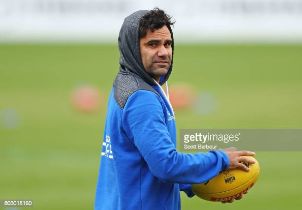 Lindsay Thomas of the Kangaroos runs with the ball during a North Melbourne Kangaroos AFL training session at Arden Street Ground on June 29 2017 in...