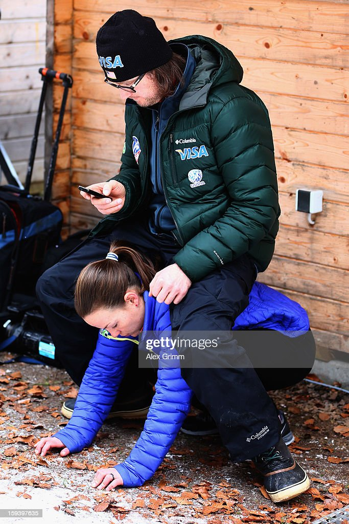 Lindsay Van of the USA prepares with coach Paolo Bernardi for the FIS Ski Jumping World Cup Women's HS108 on January 13, 2013 in Titisee-Neustadt, Germany.