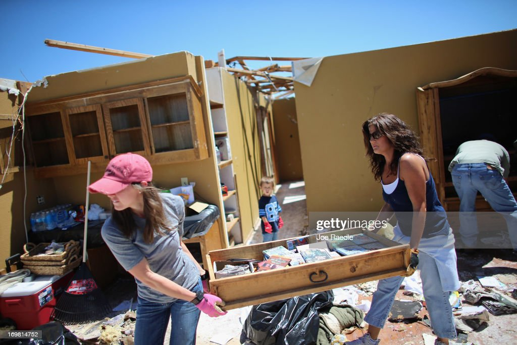 Lindsay Welton (L) and Dana Givens salvage what they can from a relative's home after it was destroyed by a tornado on June 2, 2013 in El Reno, Oklahoma. The tornado ripped through the area friday killing at least 9 people, injuring many and destroying homes and buildings.