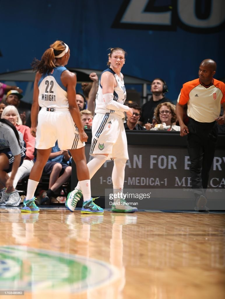 Lindsay Whalen #13 and Monica Wright #22 of the Minnesota Lynx celebrate after a play against the San Antonio Silver Stars during the WNBA game on June 11, 2013 at Target Center in Minneapolis, Minnesota.