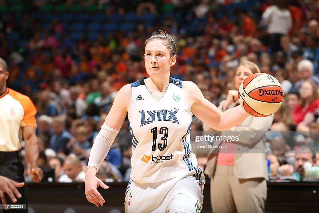 Lindsay Whalen #13 looks to pass against the Phoenix Mercury during the WNBA game on July 24, 2013 at Target Center in Minneapolis, Minnesota.