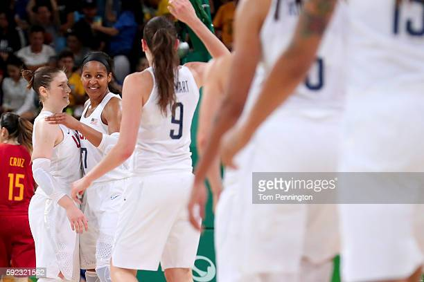 Lindsay Whalen Maya Moore and Breanna Stewart of United States celebrate a play during the Women's Gold Medal Game between United States and Spain on...