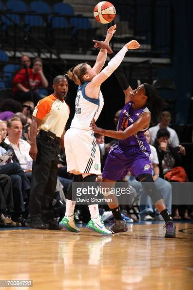 Lindsay Whalen of the Minnesota Lynx and Alexis Hornbuckle of the the Phoenix Mercury fight for the ball during the WNBA game on June 6 2013 at...