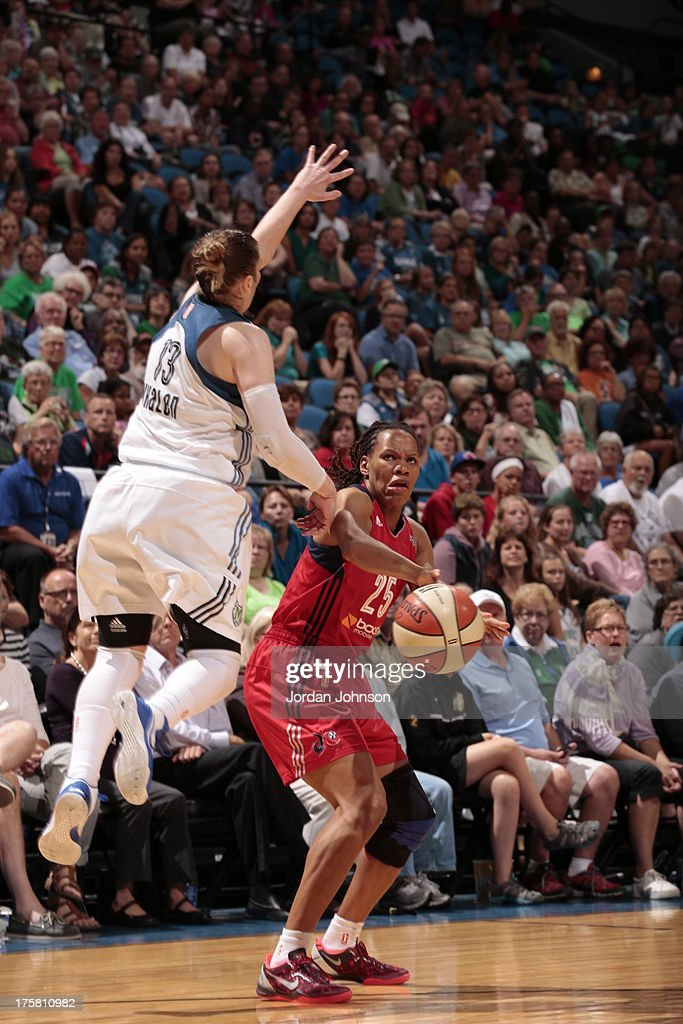 <a gi-track='captionPersonalityLinkClicked' href=/galleries/search?phrase=Lindsay+Whalen&family=editorial&specificpeople=208984 ng-click='$event.stopPropagation()'>Lindsay Whalen</a> #13 of the Minnesota Lynx attempts to block <a gi-track='captionPersonalityLinkClicked' href=/galleries/search?phrase=Monique+Currie&family=editorial&specificpeople=553598 ng-click='$event.stopPropagation()'>Monique Currie</a> #25 of the Washington Mystics during the WNBA game on August 8, 2013 at Target Center in Minneapolis, Minnesota.