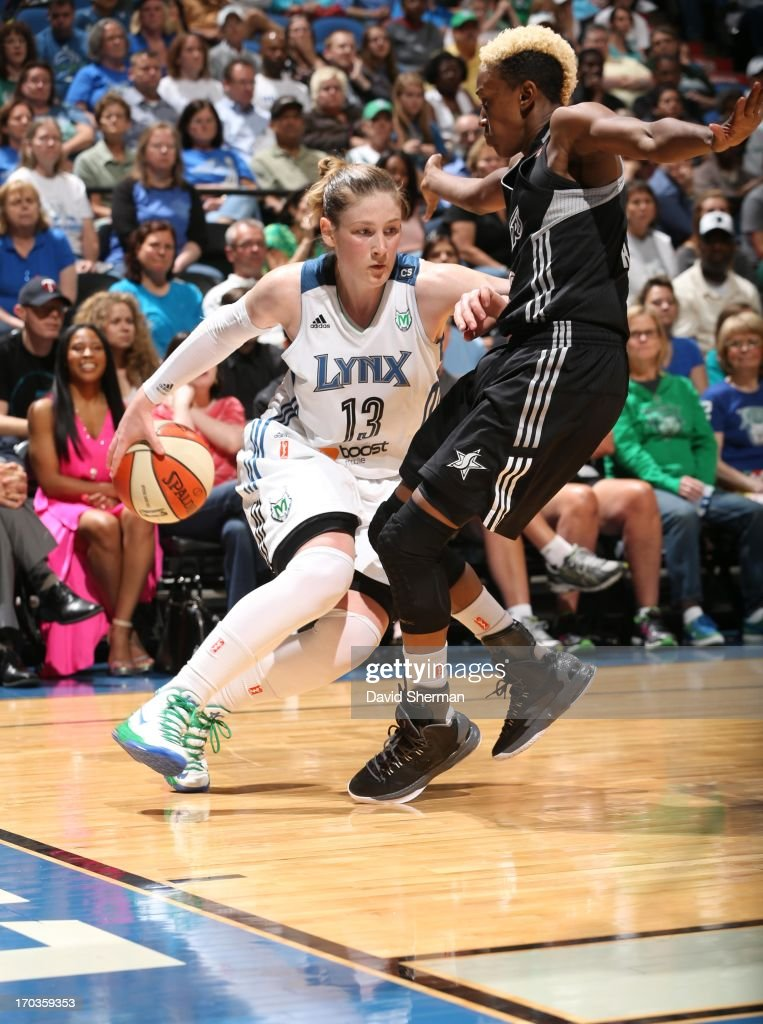 Lindsay Whalen #13 of the Minnesota Lynx attempts to drive to the basket against Danielle Robinson #13 of the San Antonio Silver Stars during the WNBA game on June 11, 2013 at Target Center in Minneapolis, Minnesota.