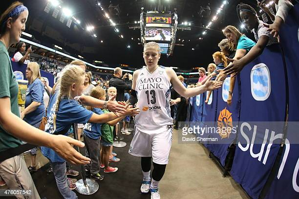 Lindsay Whalen of the Minnesota Lynx celebrates with fans after the game against the Tulsa Shock during the season opener of their WNBA game on June...