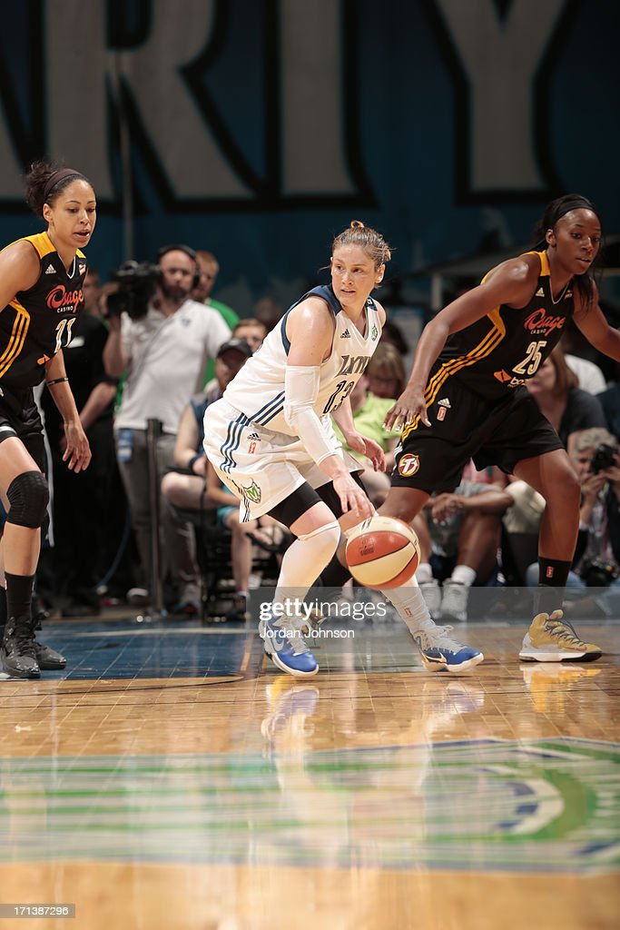 <a gi-track='captionPersonalityLinkClicked' href=/galleries/search?phrase=Lindsay+Whalen&family=editorial&specificpeople=208984 ng-click='$event.stopPropagation()'>Lindsay Whalen</a> #13 of the Minnesota Lynx dribbles against Jennifer Lacy #21 and Glory Johnson #25 of the the Tulsa Shock during the WNBA game on June 23, 2013 at Target Center in Minneapolis, Minnesota.