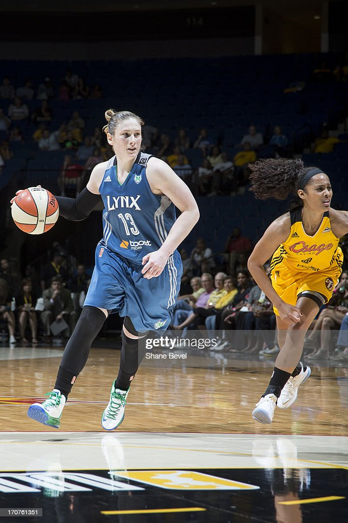 Lindsay Whalen #13 of the Minnesota Lynx dribbles the ball against the Tulsa Shock during the WNBA game on June 14, 2013 at the BOK Center in Tulsa, Oklahoma.