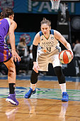 Lindsay Whalen of the Minnesota Lynx dribbles the ball against the Phoenix Mercury during Game One of the WNBA Western Conference Finals on September...